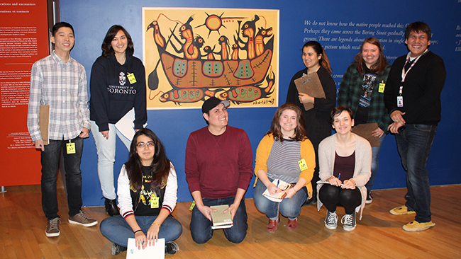 Youth Cabinet members explore the Daphne Cockwell Gallery of Canada: First Peoples with Tyler Pennock.