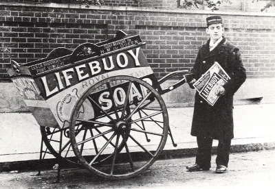 An archival photo of a man pulling a Lifebuoy Soap cart. Again no mention of its whale fat origins. Image credit - W.J. Reader