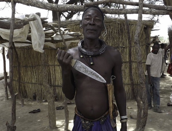 Himba man showing his knife