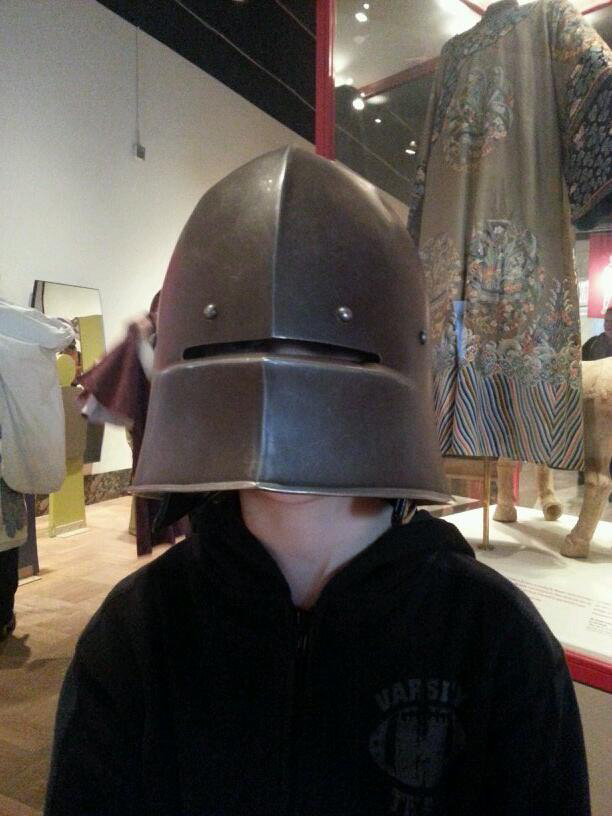 Families and kids can try on costumes in the CIBD Discovery Gallery, like this medieval knight's helmet.