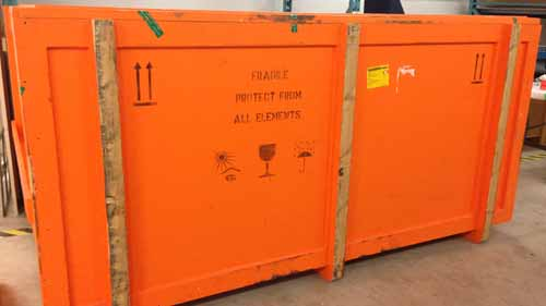"Crate with message ""Fragile. Protect from all elements"" and other shipping icons."