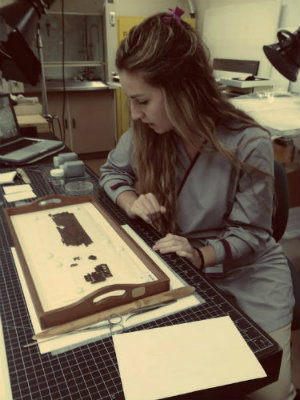 Natasa Krsmanovic examining papyrus fragments in the paper conservation lab. Photo by Jaime Clifton-Ross