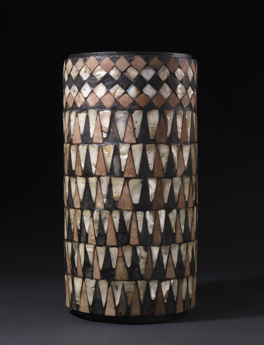Mosaic column drum - Shell, pink limestone, and black shale c. 2500 BC From Tell al-'Ubaid, Ninhursag Temple H 59cm, Diam. 31cm  BM 115328 © The Trustees of the British Museum