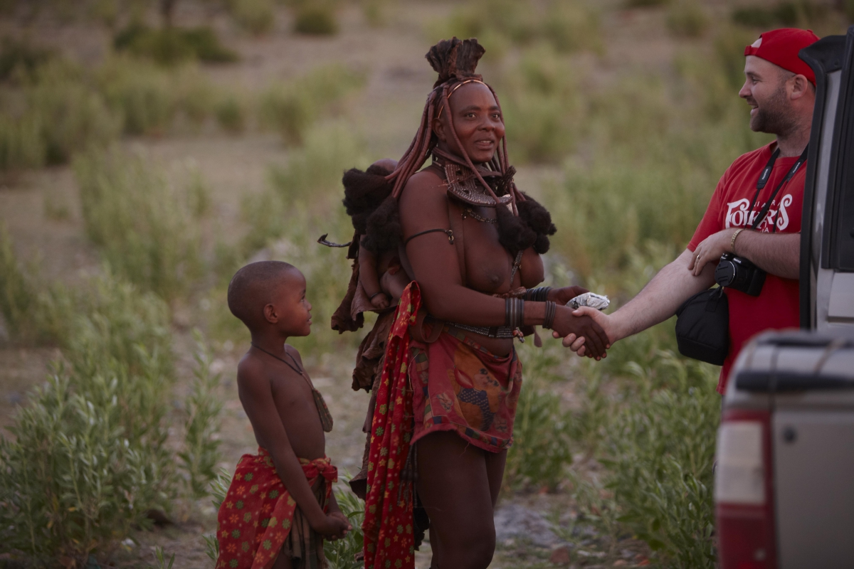 Paul Welhauser greeting a himba woman