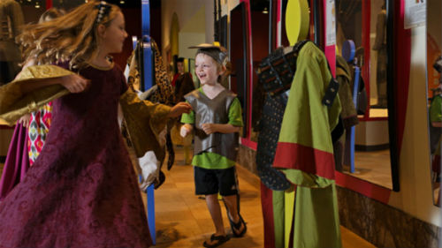 Children playing dress-up in the CIBC Discovery Gallery ROM