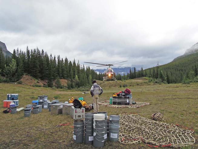 Sorting out field gear in nets at the field helipad (image courtesy of Gabriela Mangano)