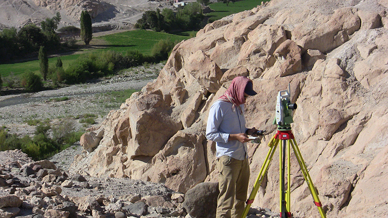 A man maps the archaeological site.