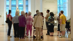A group of visitors enjoy a guided tour of the galleries.