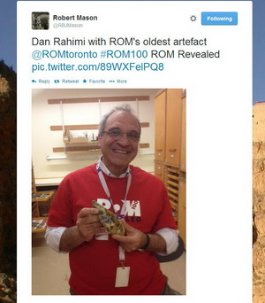ROM100 Celebration Twitter picture of Dan Rahimi holding the Rom's oldest artefact