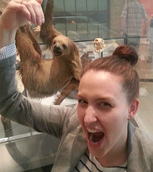 Woman posing with sloth in the Gallery of Mammals on Level 2.