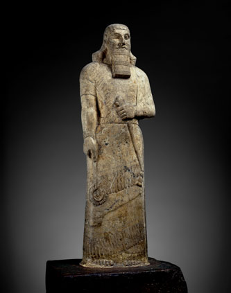Statue of Ashurnasirpal II -  Magnesite. Nimrud, northern Iraq,  Neo-Assyrian  875 - 860 BCE BM 118871    © The Trustees of the British Museum.