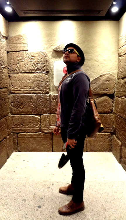 Standing in a replica of a tomb in the Gallery of Africa: Egypt.