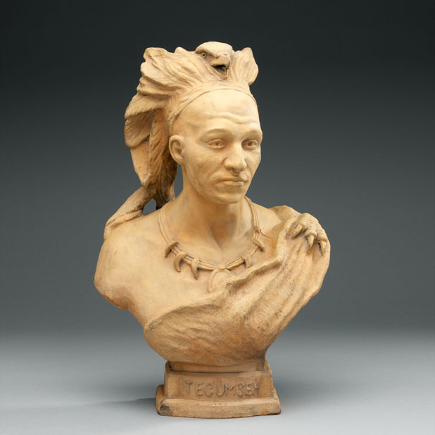 Terracotta bust on grey background.