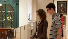 Visitors looking at a display in one of the ROM's galleries