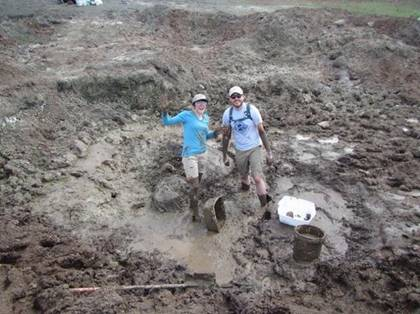 People standing in mud