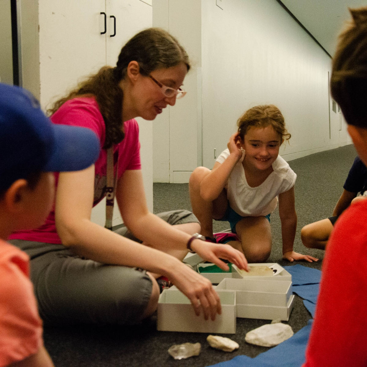 Bethany and her class look at hands on specimens from the Rocks and Minerals collections. Image: Michael Berger