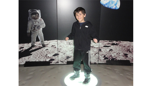child stands on moon rock
