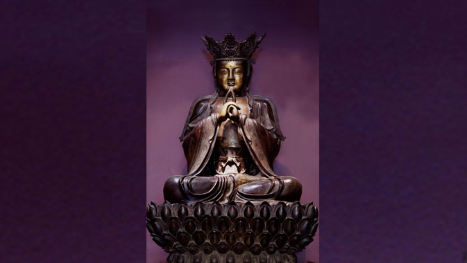 The bronze Vairocana Buddha sits majestically in the Samuel Hall Currelly Gallery.