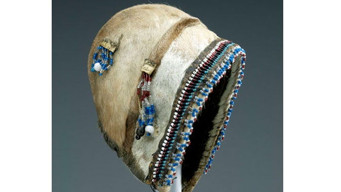 Inuit child's summer bonnet, made of caribou skin decorated with beadwork.