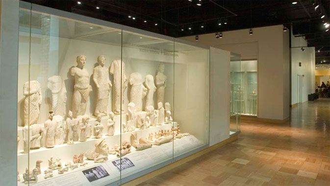A reconstructed open-air sanctuary features the ROM's collection of votive sculptures from the Sanctuary of Apollo at Frangissa.