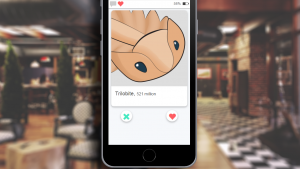 a phone displays a dating app with a picture of a trilobite