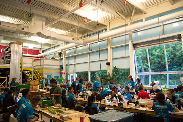Wide view of the species depot at the 2015 Ontario BioBlitz, where scientists bring back specimens to examine and identify along tables with microscopes and field guides. Photo by Krystal Seedial