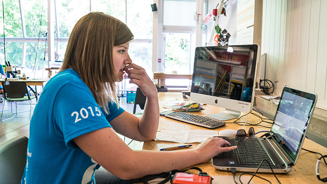 Angela Telfer, database coordinator for the Ontario BioBlitz program sits hard at work at a computer in the middle of the species depot during the 2015 event. Photo by Stacey Lee Kerr