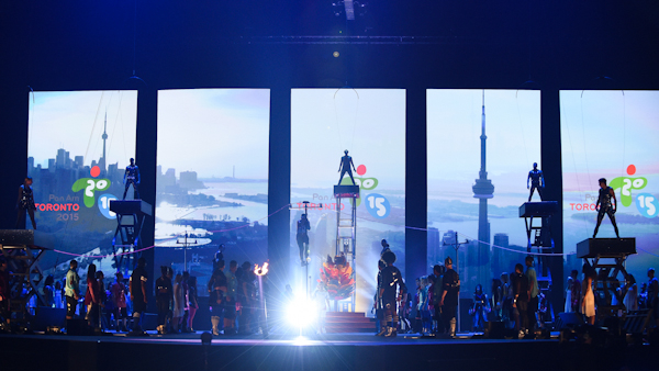 A stage performance with images of Toronto in the background for the opening ceremonies of the 2015 Pan Am Games in Toronto