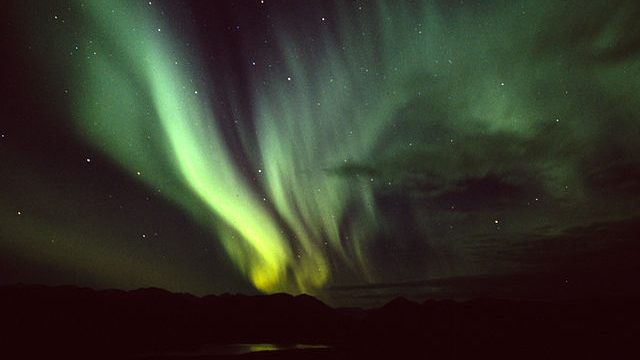 The Northern Lights over Fish Lake near Whitehorse, Yukon Territory. Photo by Anthony DeLorenzo via Wikimedia Commons
