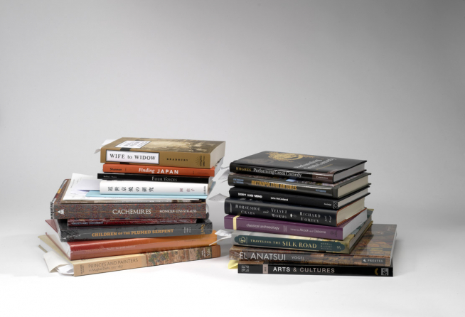 Two stacks of books that include images from the Royal Ontario Museum