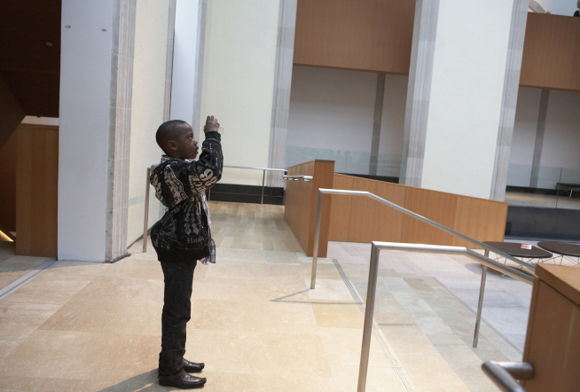 Child using his Cultural Access Pass, image courtesy of the ICC
