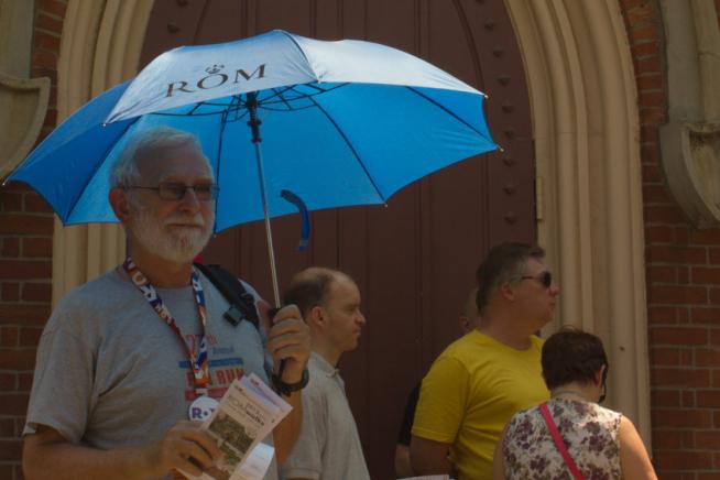 David standing under a blue umbrella ready to begin a ROM Walk.