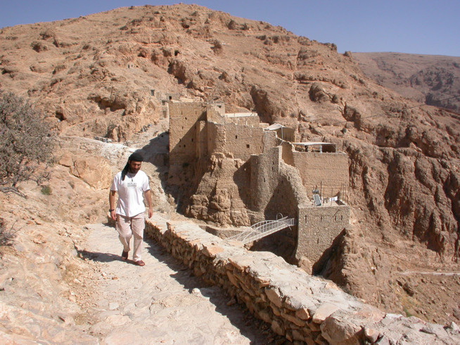 View of the old monastery buildings from the South in 2004, with then Brother Jihad, a member of the monastery.