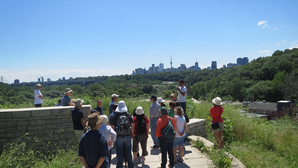 Group stands with Toronto skyline in Background