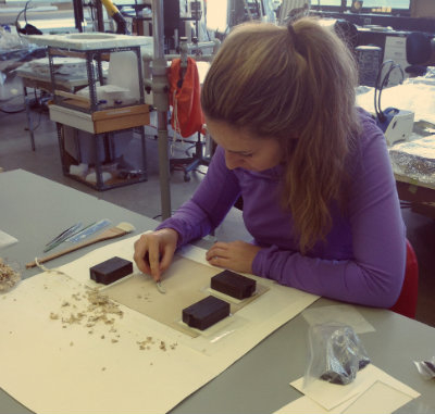 Natasa performing backing removal on an albumen photograph at her bench in the Queen's conservation lab. Photo courtesy of Natasa Krsmanovic.