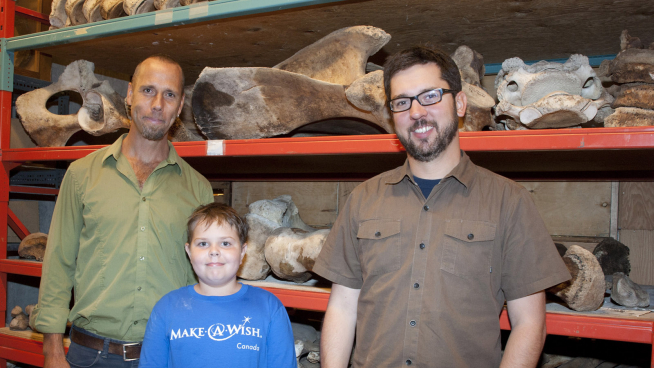 Damien in the collection room with Dr. Hans Larsson and Dr. David Evans.