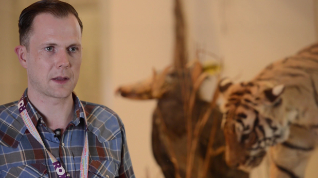 Ryan Farley, the ROM's lead concierge, near a tiger in the biodiversity gallery
