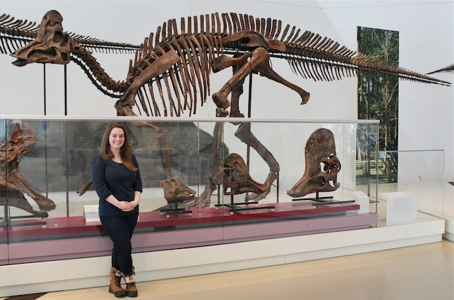 Woman standing in the Dinosaur Gallery.
