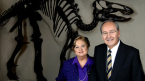 James and Louise Temerty standing in front of a dinosaur at the Royal Ontario Museum.