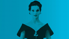 Photo of a woman in a Dior dress against a blue background
