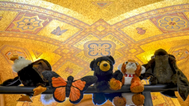 Stuffed animals beneath the ROM Rotunda mosaic ceiling