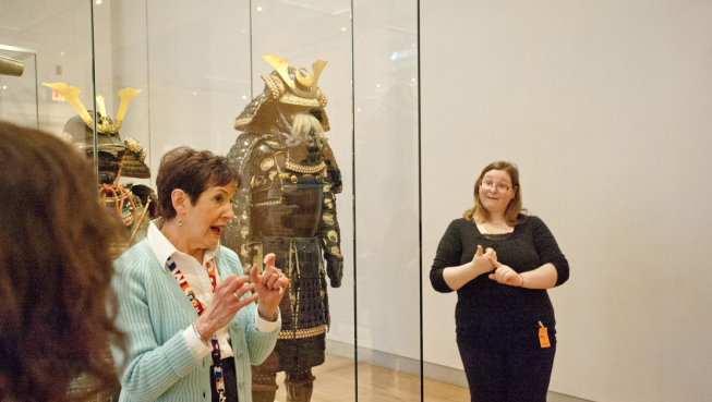 A Docent and an ASL Interpreter during a ROM ASL-Interpreted Tour in the Home > Exhibitions & Galleries > Galleries > World-Cultures > Prince Takamado Gallery of Japan Prince Takamado Gallery of Japan