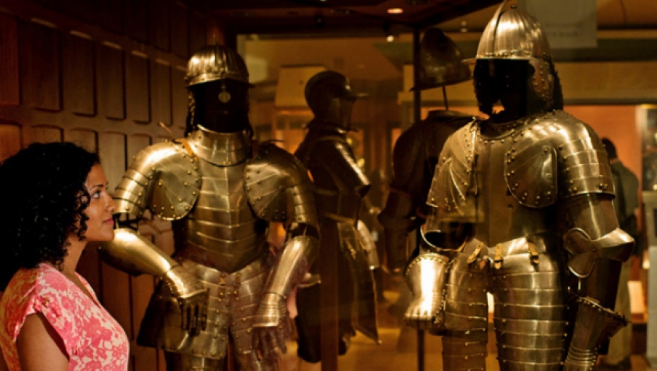 Photo of a woman looking at suits of armour