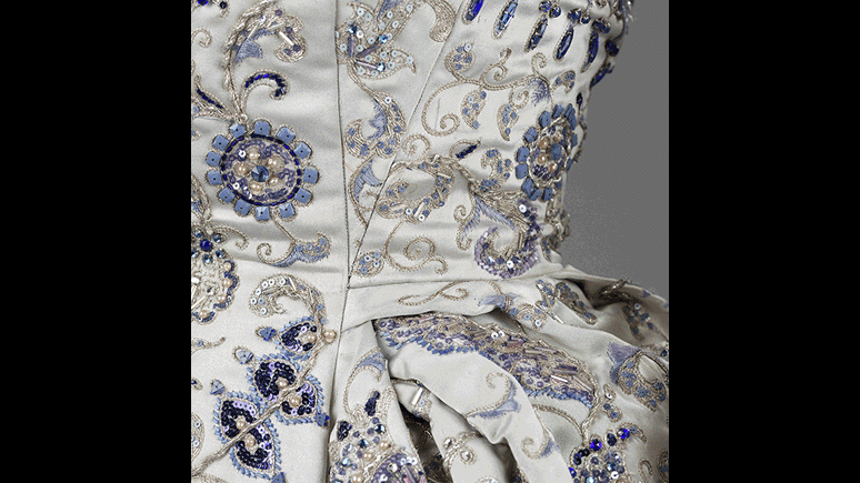 Palmyre ball gown (detail). Satin acetate textile by Robert Perrier embroidered with silver filé, sequins, pearls, jewels, and bone. Christian Dior, Paris, Automne-Hiver 1952-3. Ligne Profilée. Gift of Mrs. M. James Boylen.
