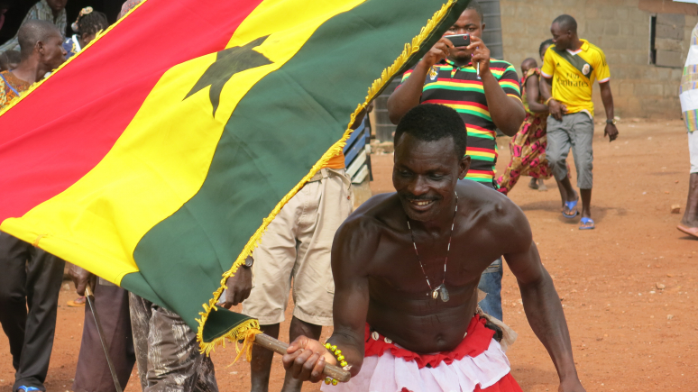 Man dancing with flag.