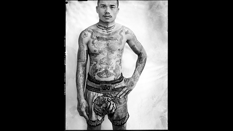 Male with tattoos on torso.