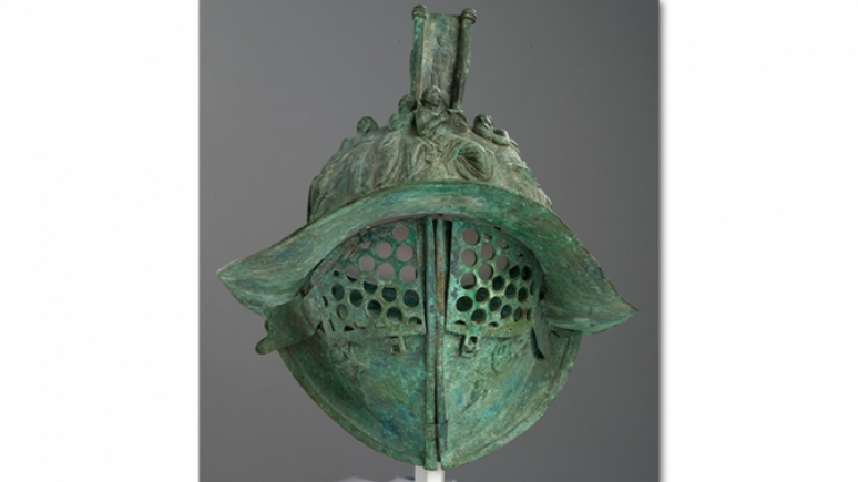 Gladiator Helmet: The bronze helmet of a Roman gladiator copies the original found at Pompeii in southern Italy. Gladiatorial helmets with elaborate decoration are very rare, so the ROM purchased this finely made copy for teaching purposes in the galleries. 910.94.71