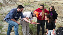 Dr. David Evans, James & Louise Temerty Chair, Vertebrate Palaeontology, with students in the field.