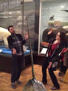 two people are startled by a digital narwhal