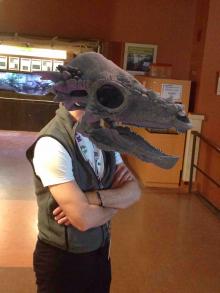 a man with the head of a dinosaur